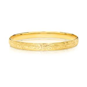 <p>Hand engraved bangle. 9ct approx. weight 18.4gm, 65mm diameter</p>