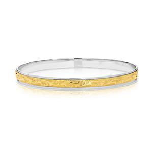Two-tone machine engraved bangle.