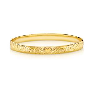 Solid bangle, half round profile. Hand engraved pattern. Approx. 1.9mm thick, 9ct approx weight 24gms, 65mm diameter