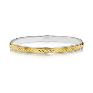 <p>Two-tone machine engraved bangle.</p>